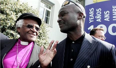 Desmond Tutu and Roger Milla