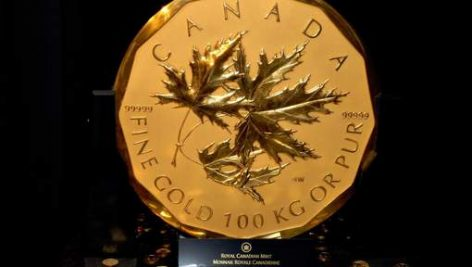 The Royal Canadian Mint today unveiled this 100-kilogram (220-pound) 99.999 percent pure gold coin at the mint in Ottawa, Ontario, Canada, Thursday, May 3, 2007.  It is the biggest and purest gold coin ever made, and carries a face value of C$1 million ($900,000).  Photographer: David Barbour/Bloomberg News.